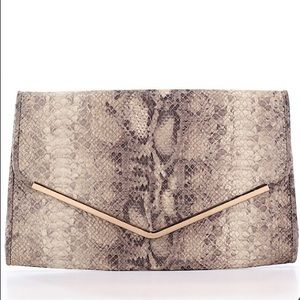 Snake print clutch with gold chain for crossbody